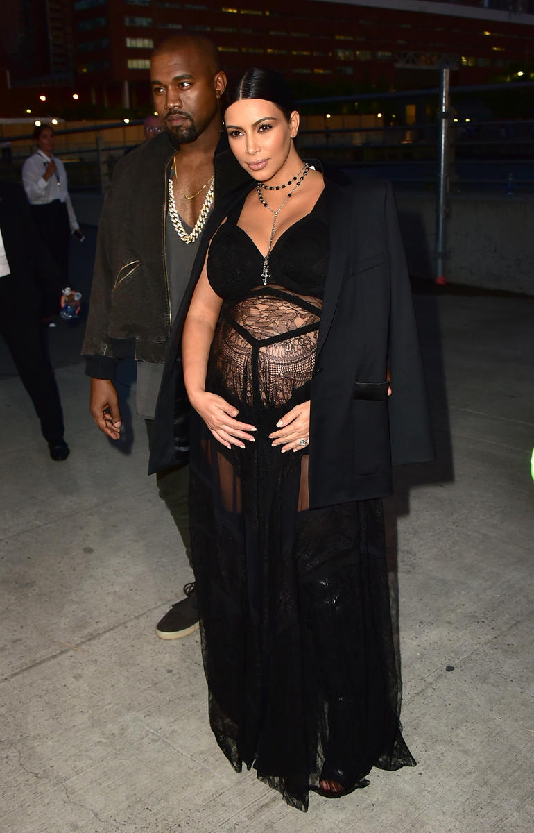 pregnant kim kardashian in a black sheer dress with kanye west