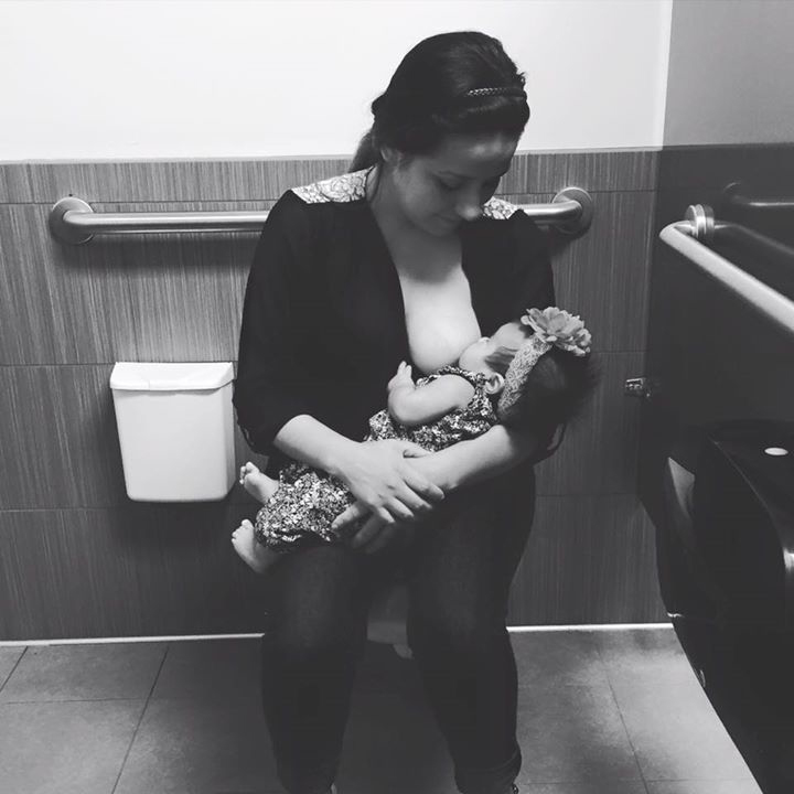 Karina Gomez breastfeeding in bathroom