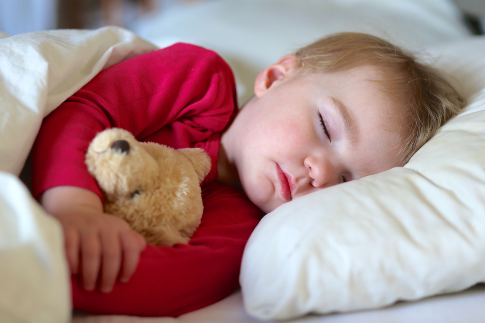 toddler boy sleeping with teddy bear