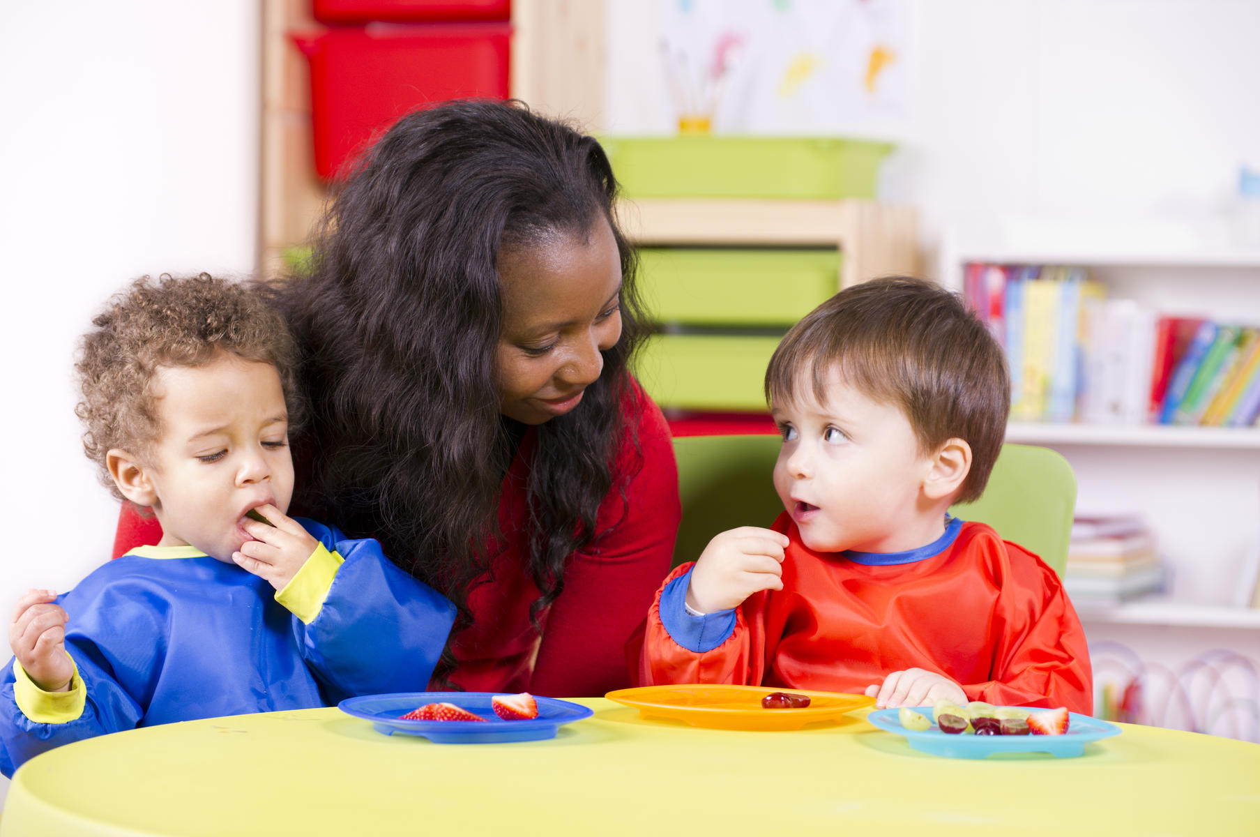 preschool teacher with two children