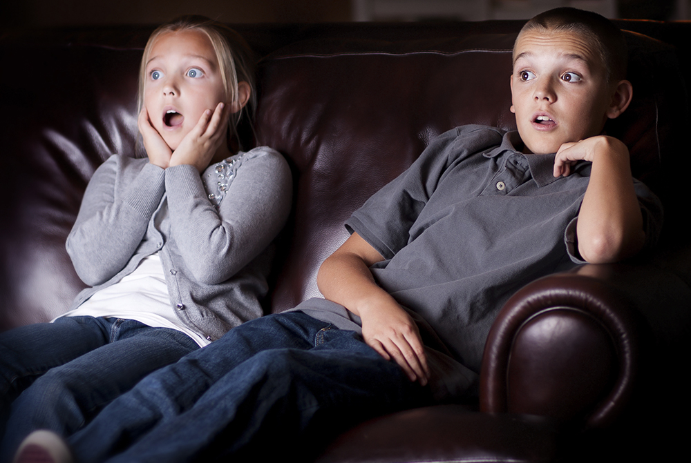 kids watching scary movie at home