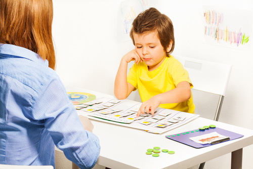 boy doing ABA therapy, sorting blocks by color