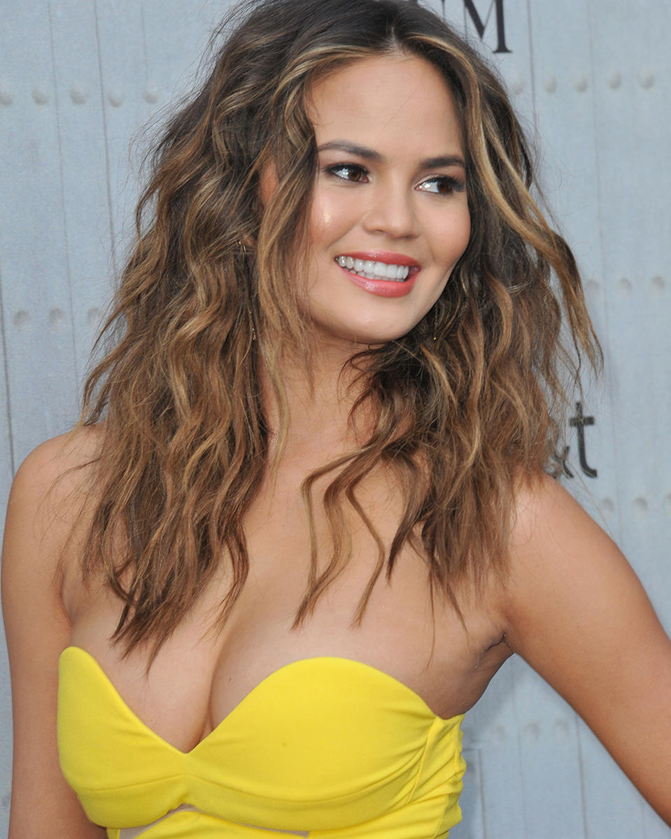 Chrissy Teigen in yellow dress 2014