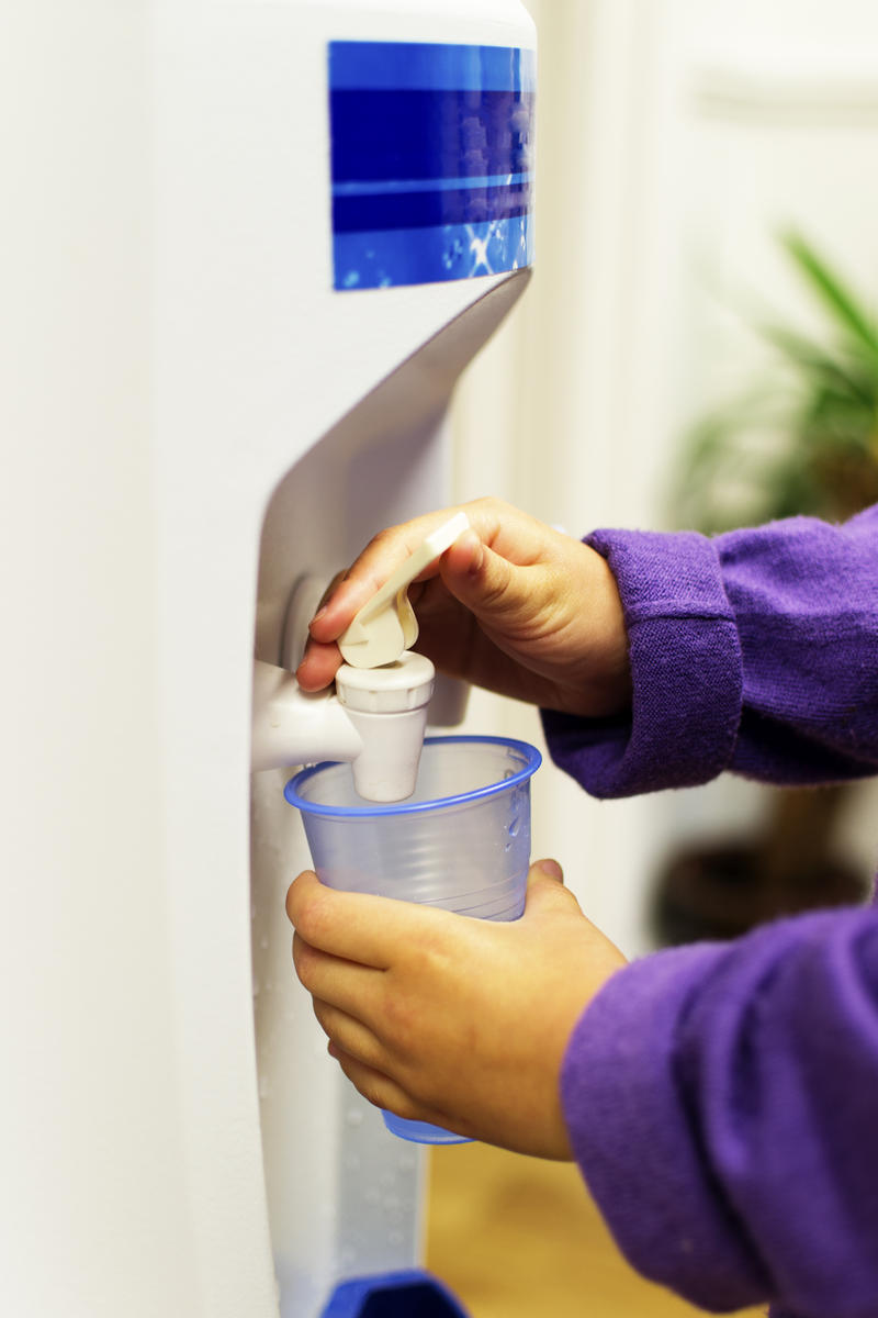 Child Getting Water From Water Cooler
