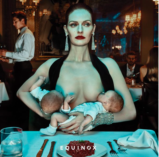 model breastfeeding in Equinox ad