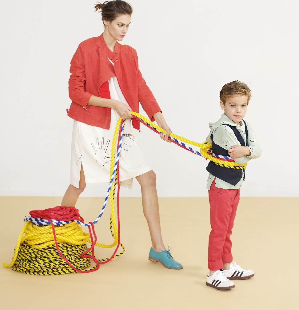 mom walking with child on leash