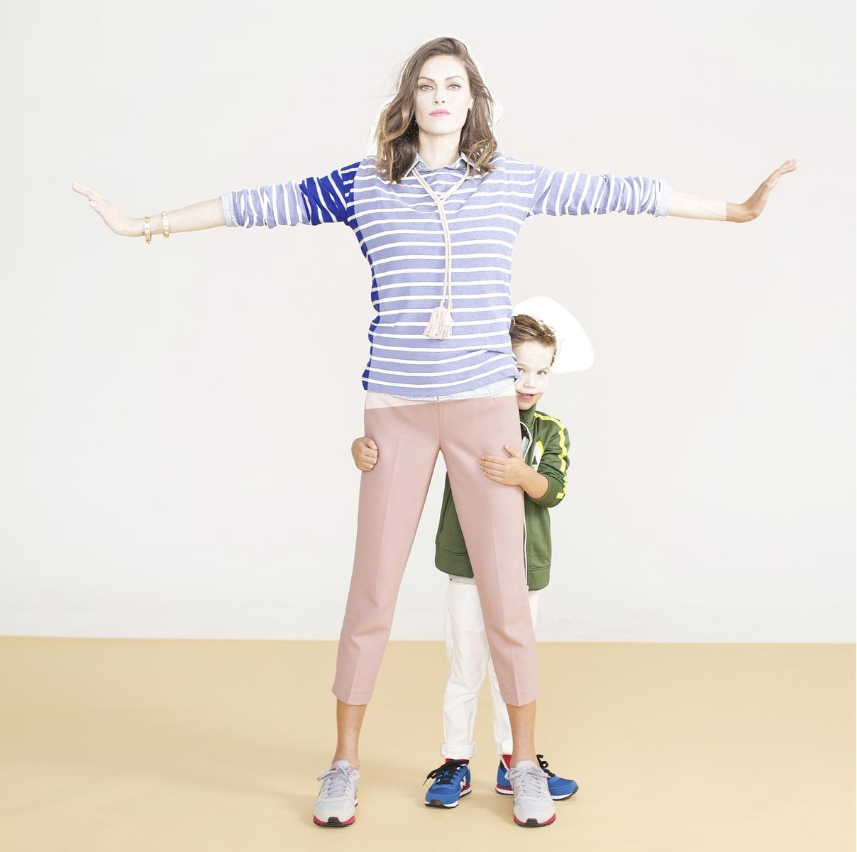 mom standing in front of child