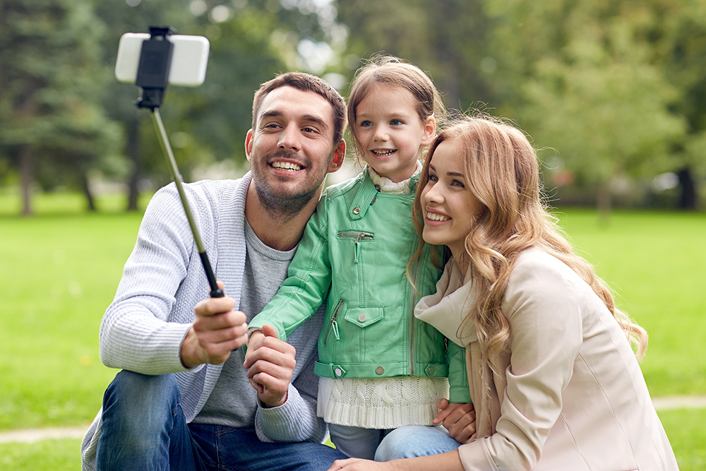 Young family talking selfie