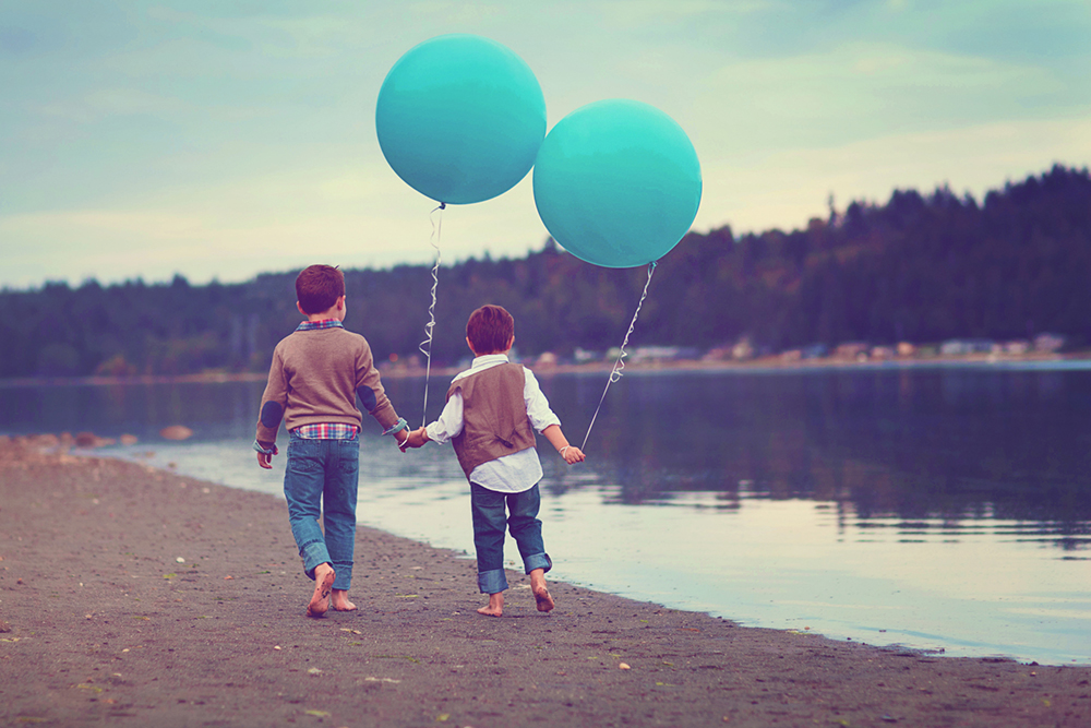 boys with blue balloons