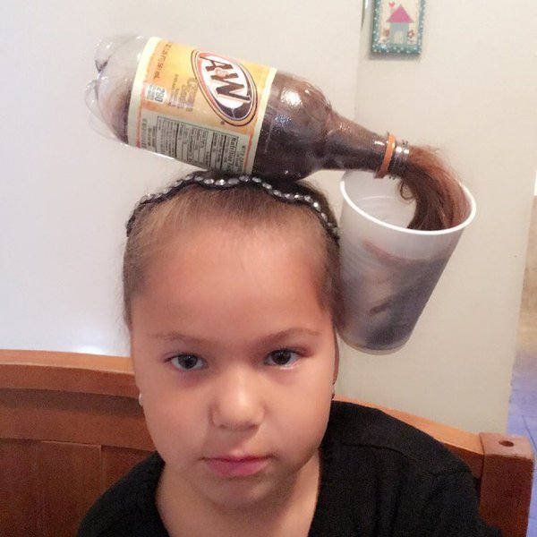 Root beer bottle spilling into cup as wacky hair day idea for kids.