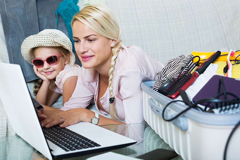 Mom and Daughter Booking Vacation With Credit Card