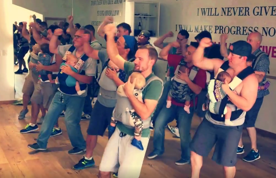"Baby-wearing dads dance to ""Play That Funky Music, White Boy"""