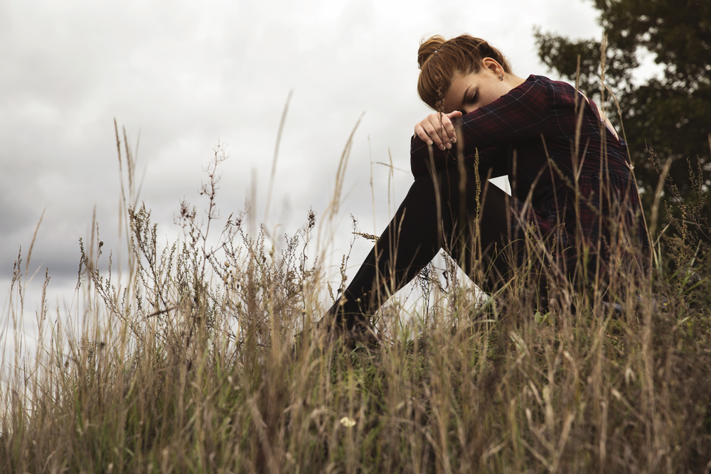 Teen alone. Sensory Processing Disorder can make teens and young adults feel isolated and out of sync with the world.