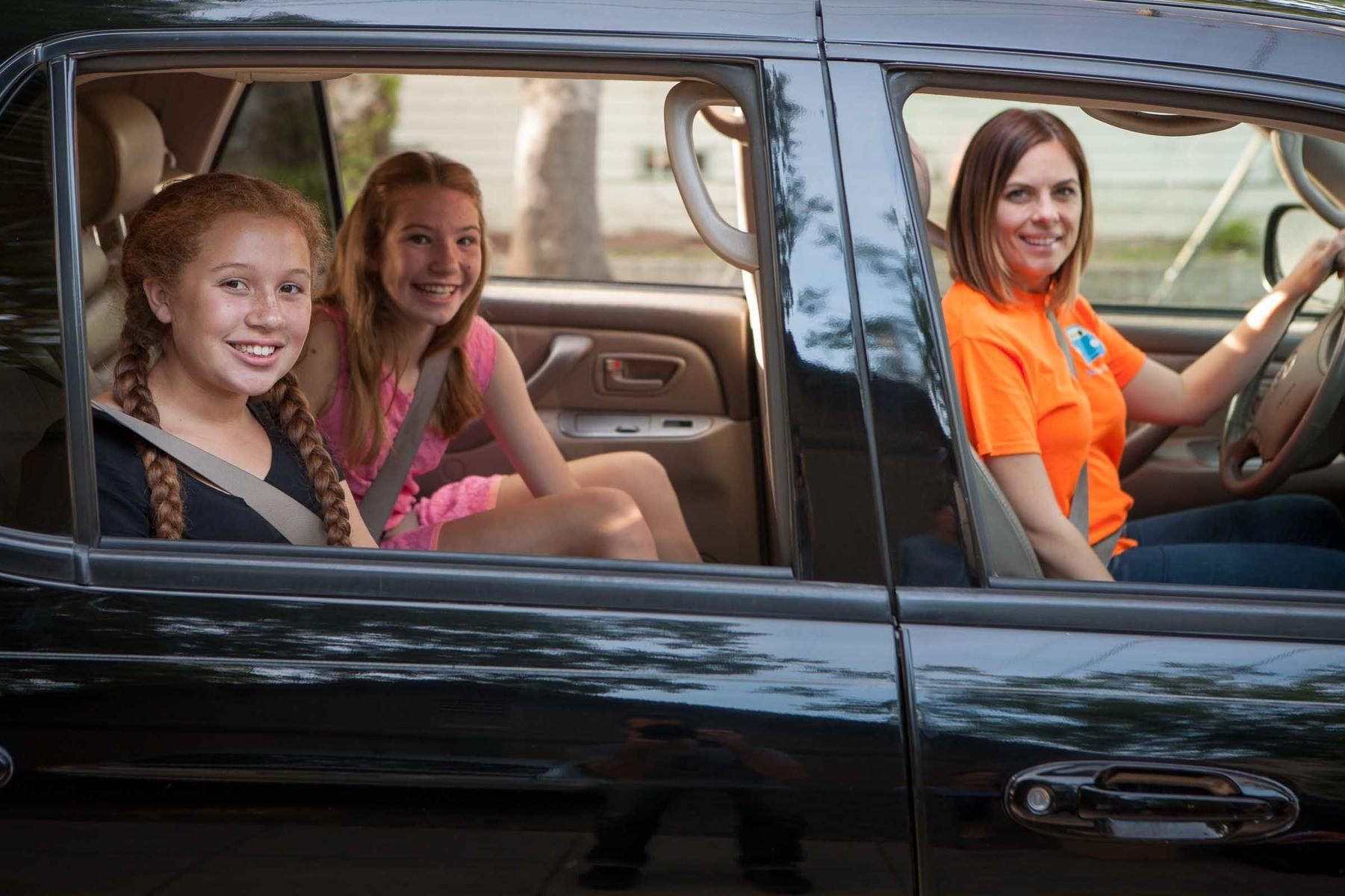 mom driving daughters