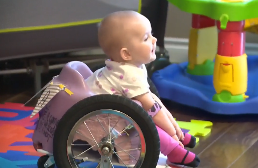 13-month-old Evelyn Moore of Canada in a DIY Wheelchair