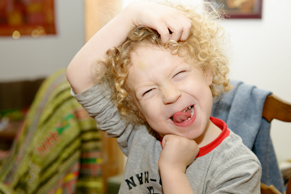 young boy making a funny face