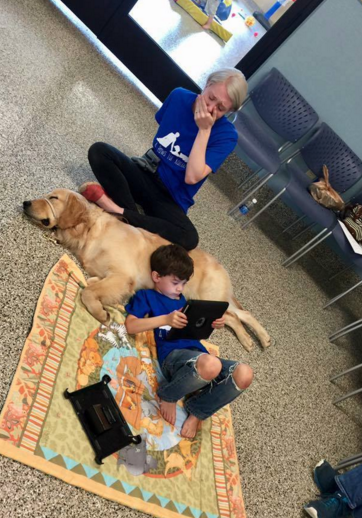 mom and son with autism service dog