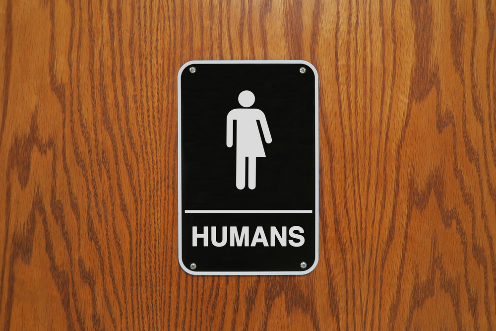 humans restroom sign