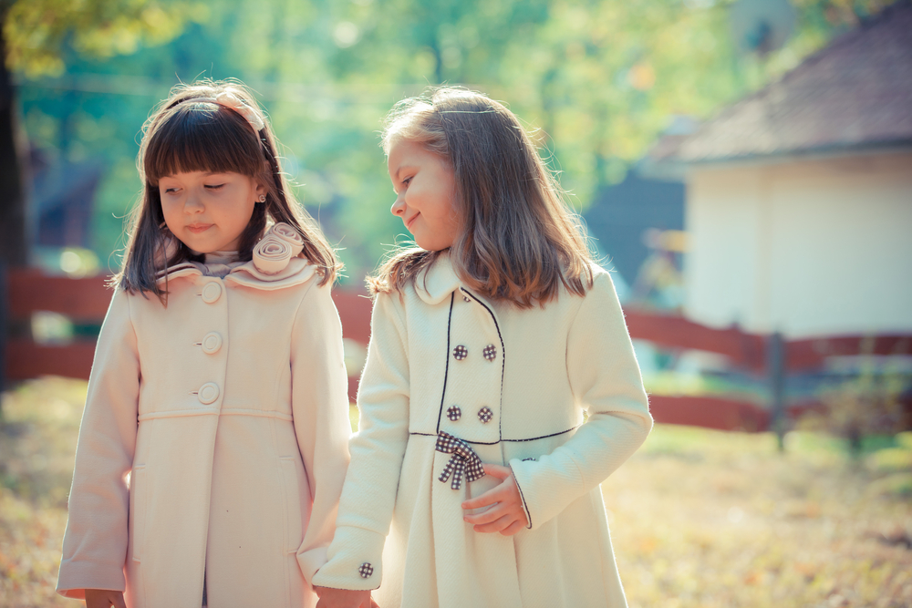 First Friendships Two Little Girls Wearing Peacoats Outside