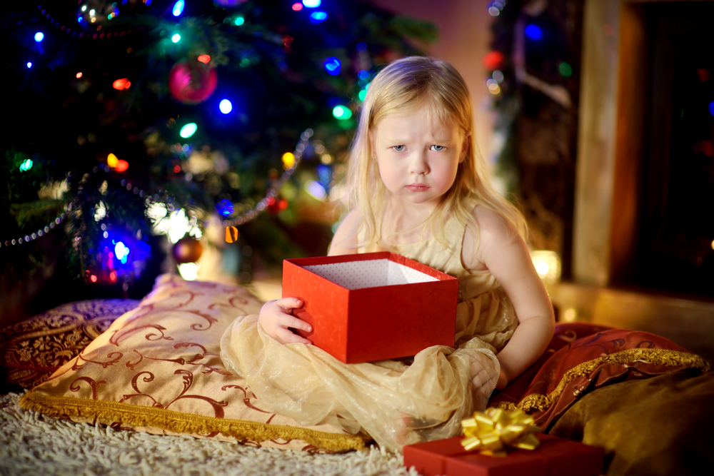 little girl unhappy with christmas gift