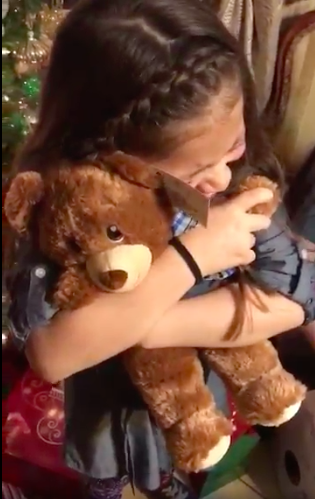 girl hugging build a bear with grandfathers voice
