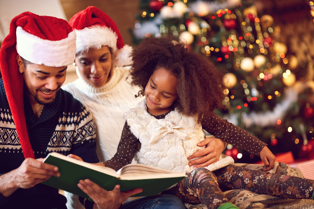 family reading a christmas story together