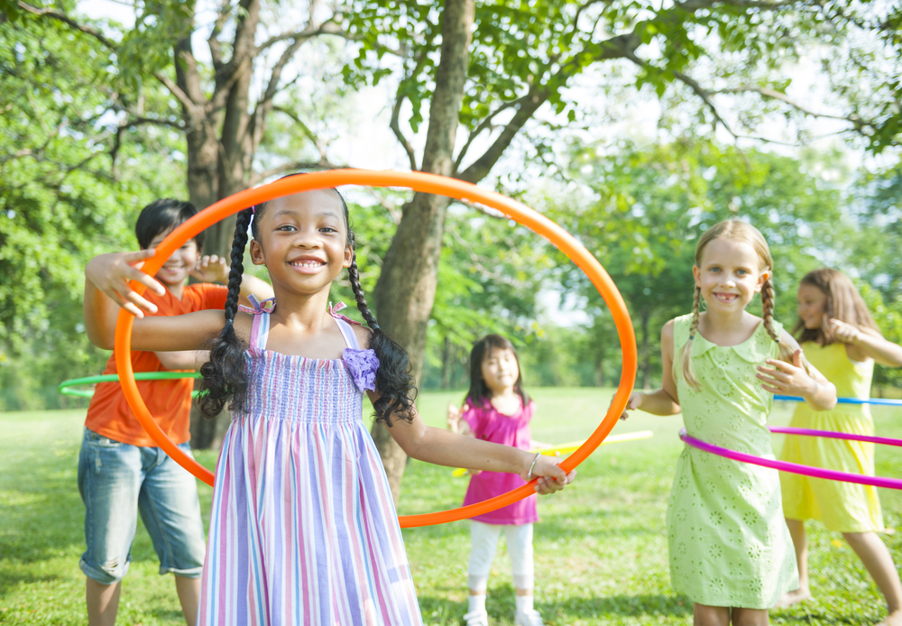 kids using hula hoop outside