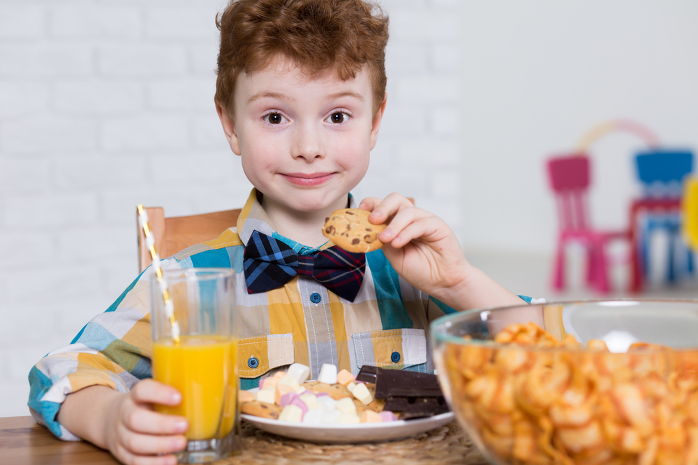 Boy eating cookies and chips