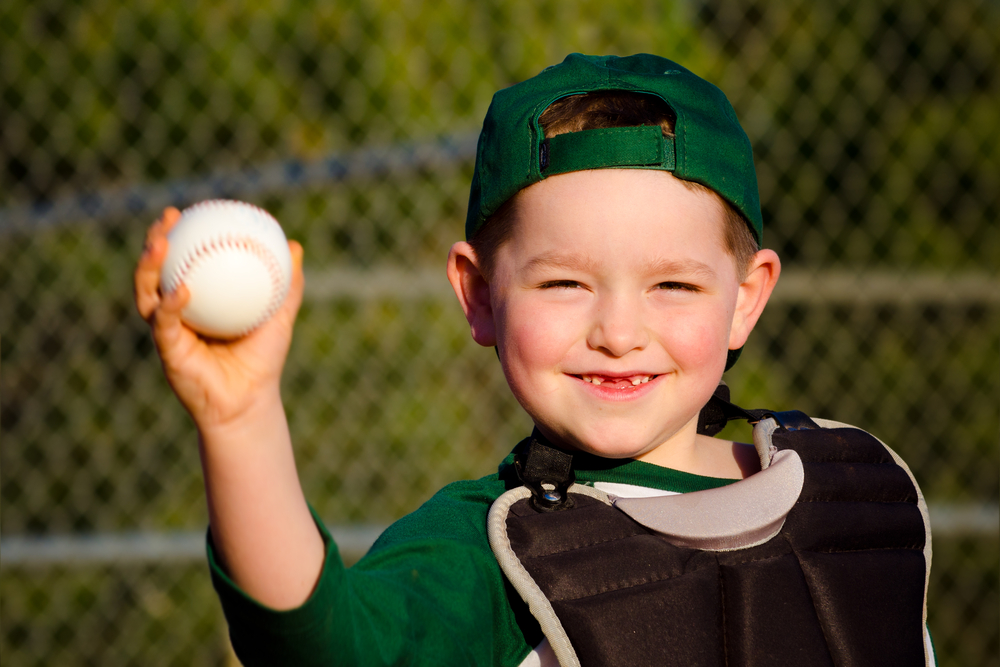 Little boy throwing a baseball