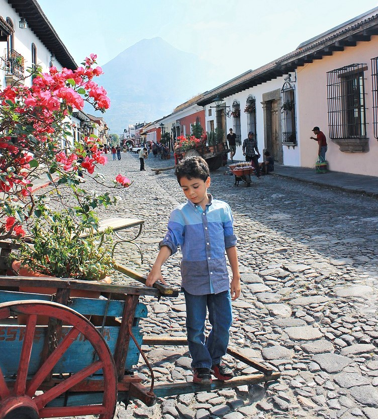Boy In Blue Shirt Walking In Guatemala City