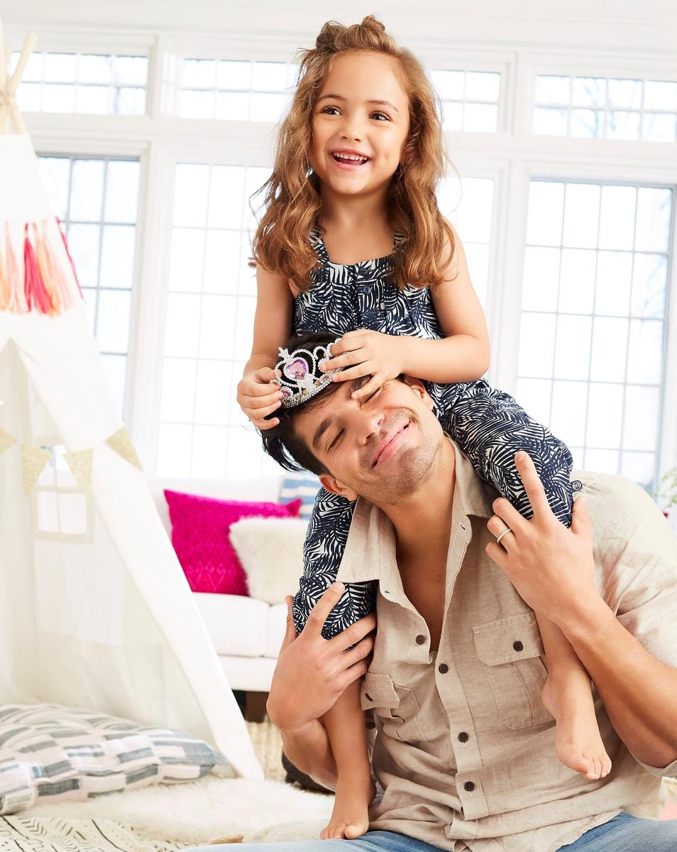 Girl on Fathers Shoulders With Princess Crown