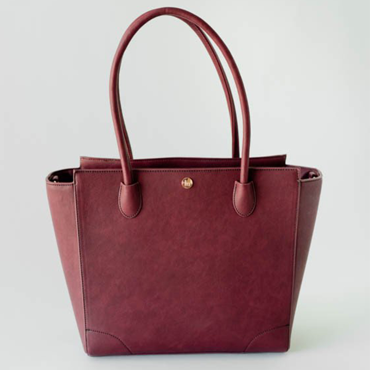 Large faux leather tote in berry color