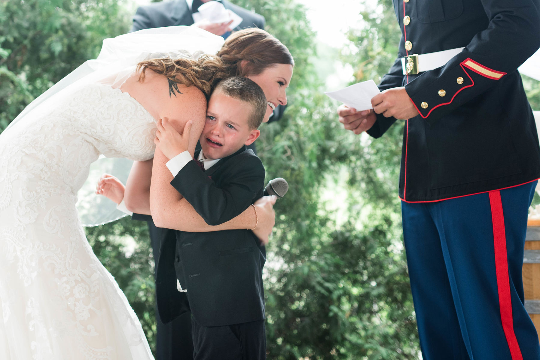 step-son overcome by emotion at wedding