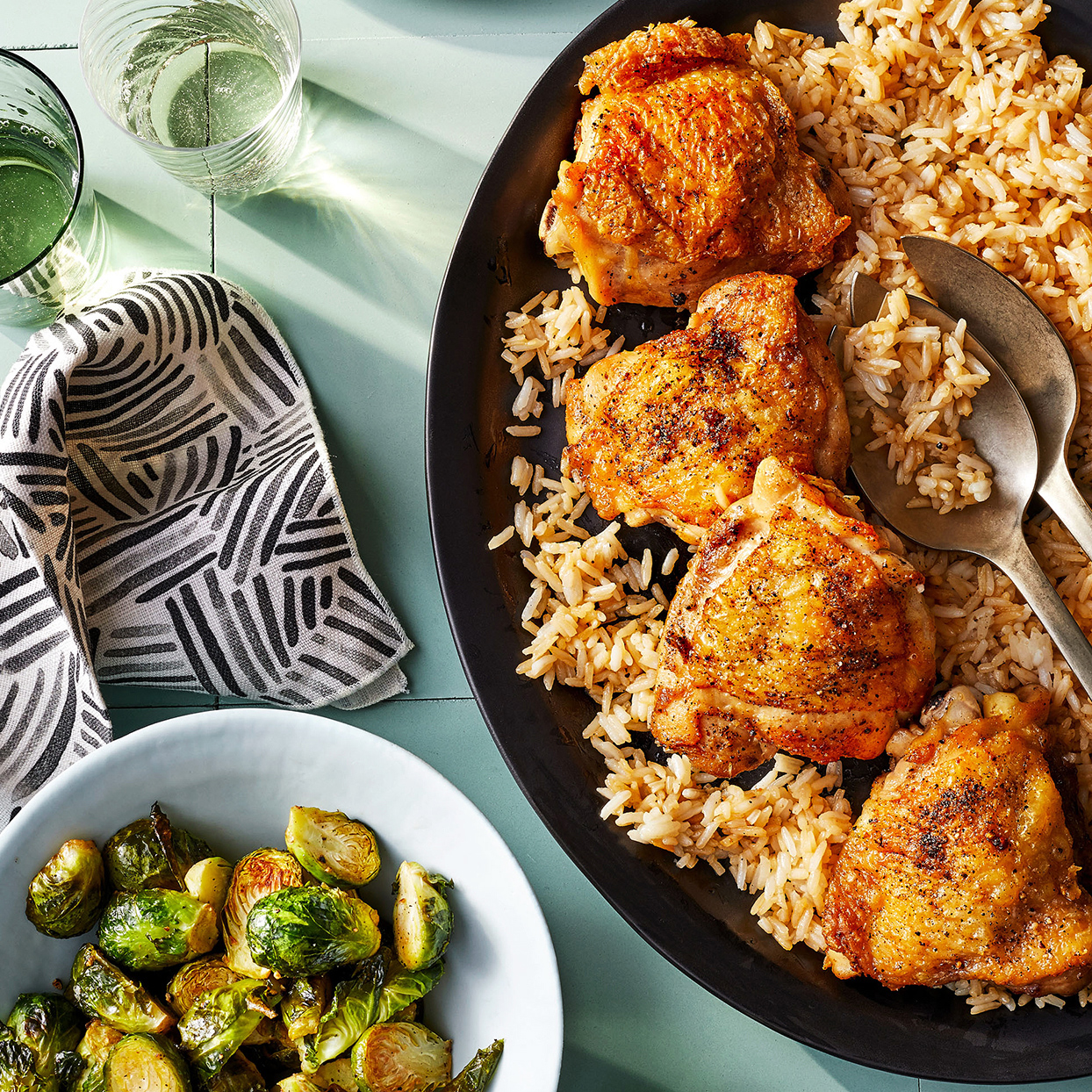 Roasted Chicken and Rice with Brussels sprouts in black and white dishes