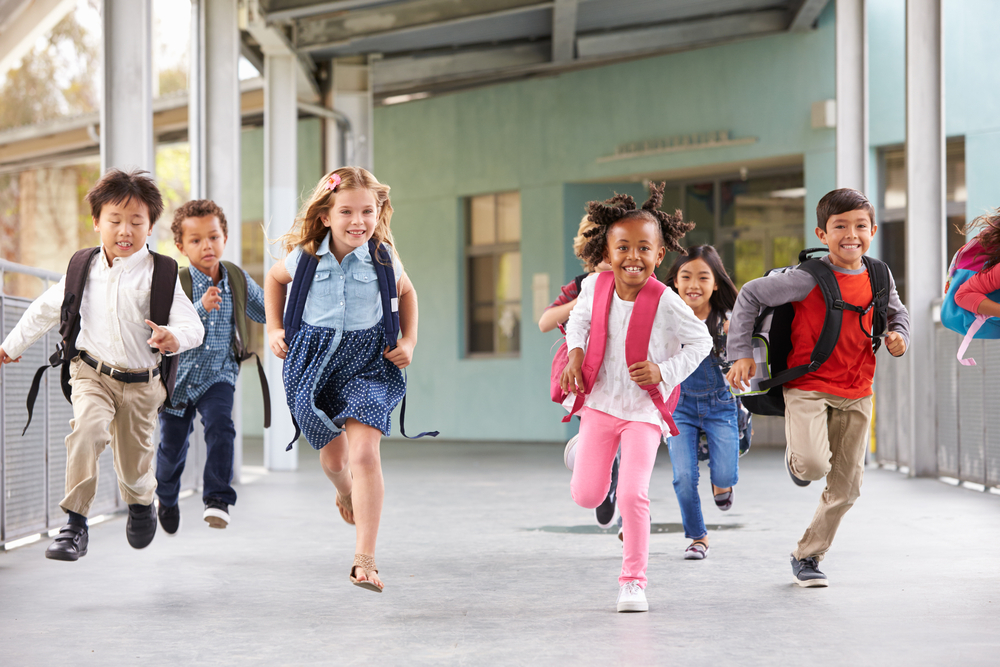 Kids running outside school