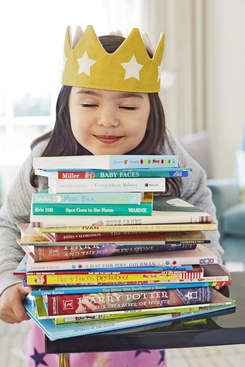 Encourage Empathy Girl Holding Stack of Books