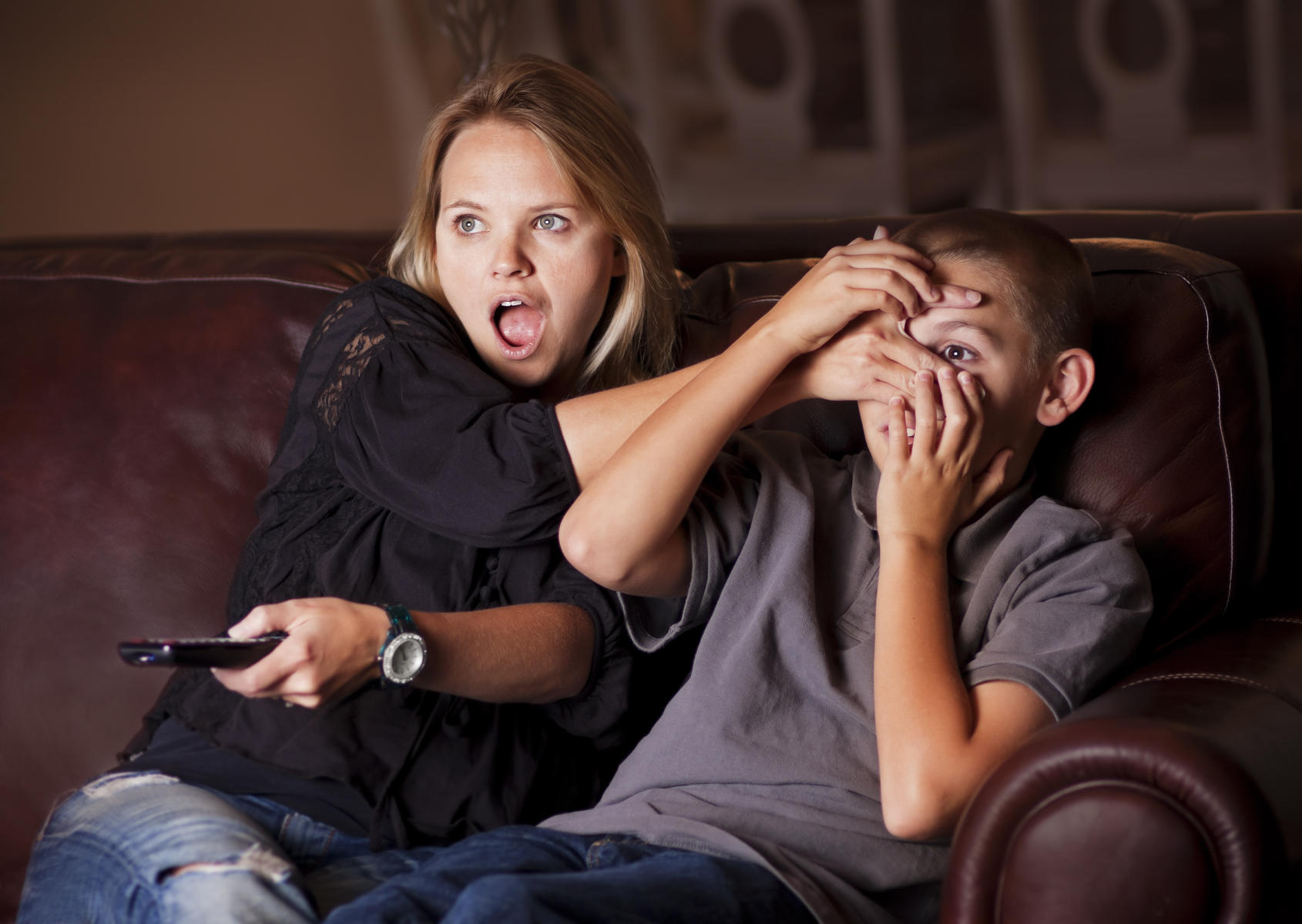 Mom Covers Sons Eyes Watching TV Surprised