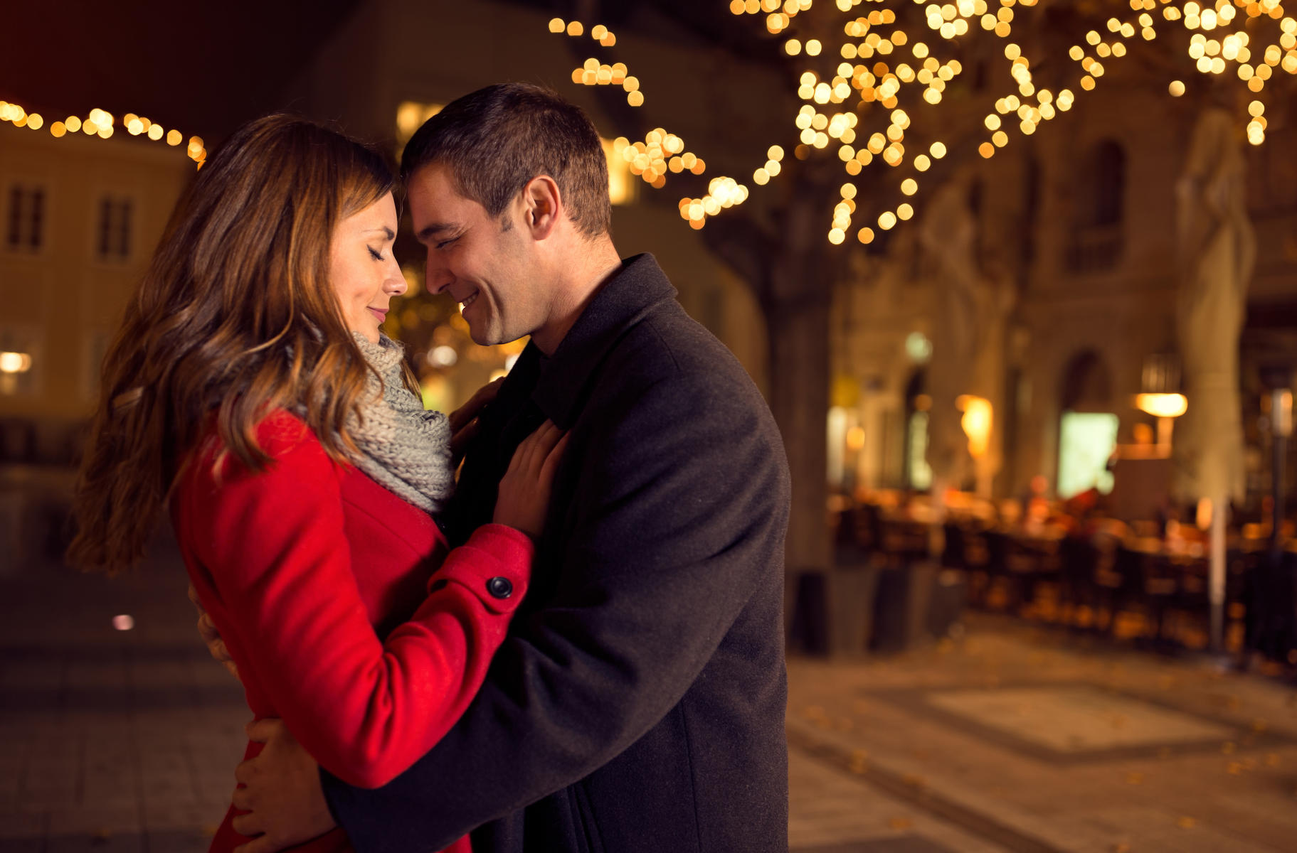 Date Night Happy Couple Embrace Outdoors Twinkle Lights