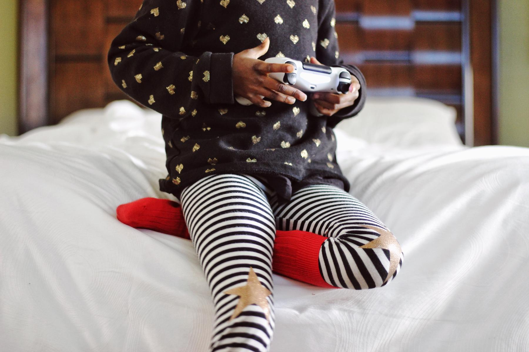 Young Girl Playing Video Game Holding Controller
