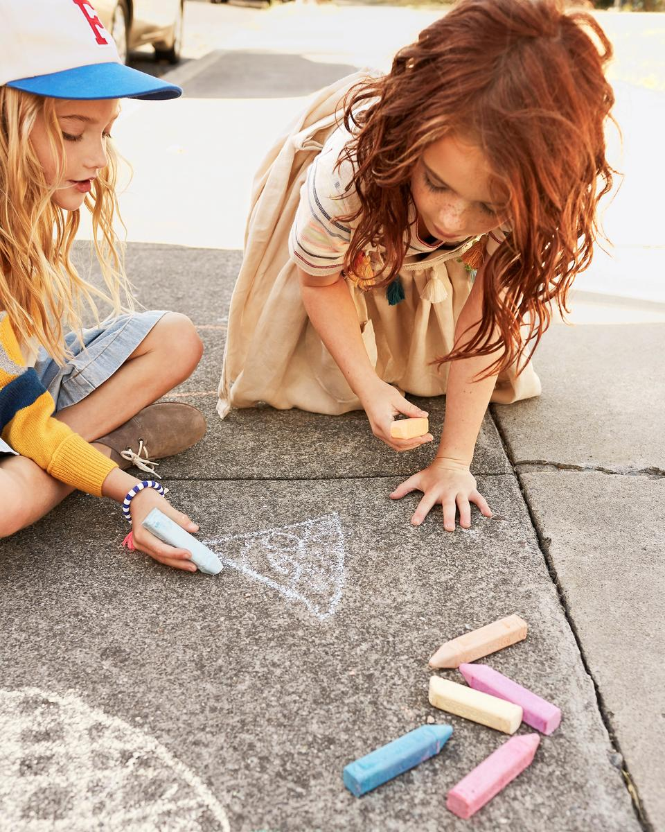 Girls Playing With Chalk On Sidewalk