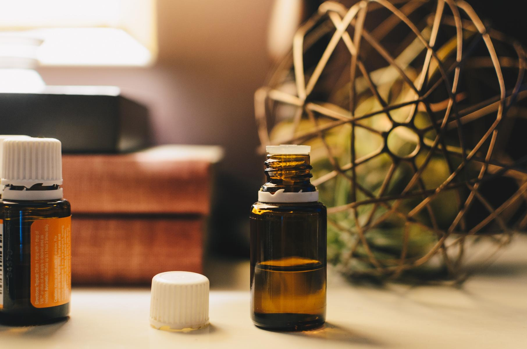 Essential Oil Bottle On Desk