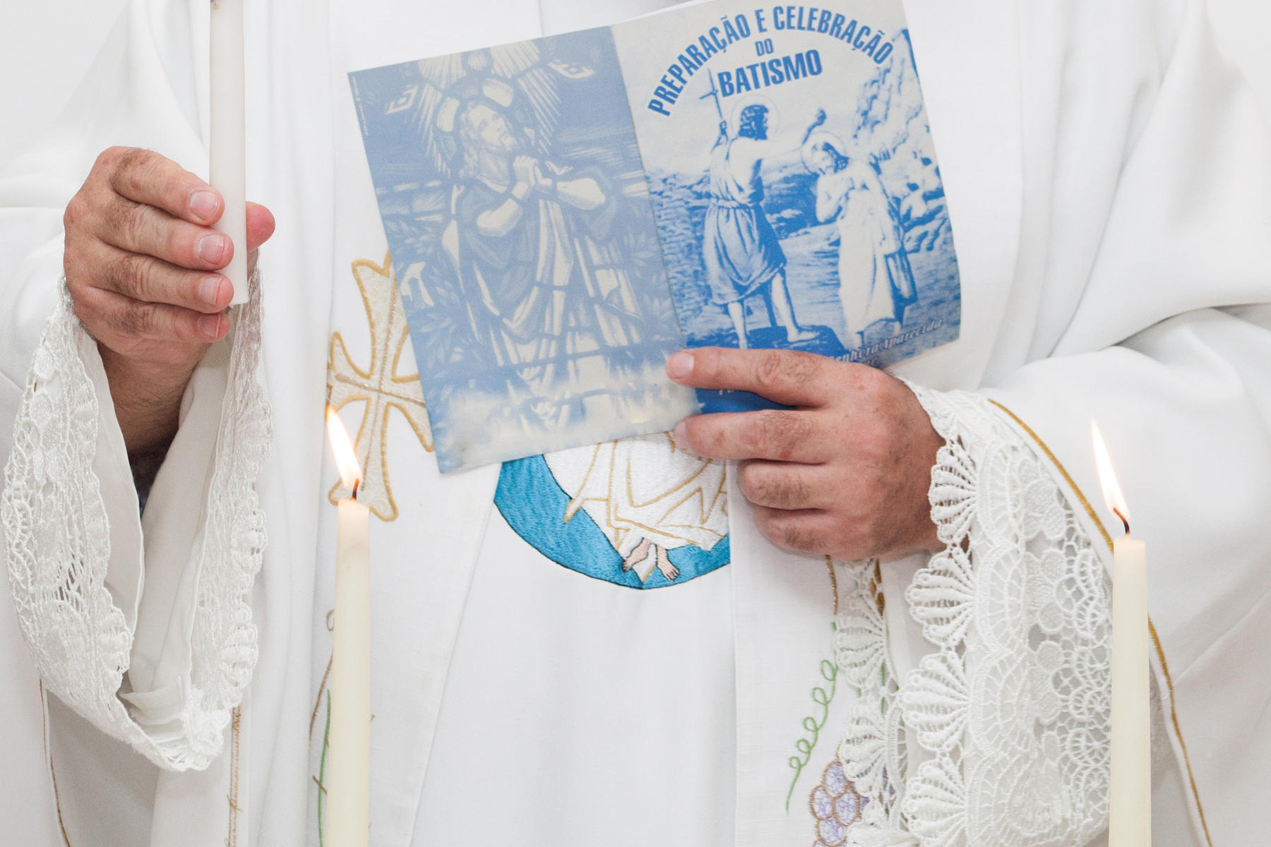 Priest Holding Baptism Book