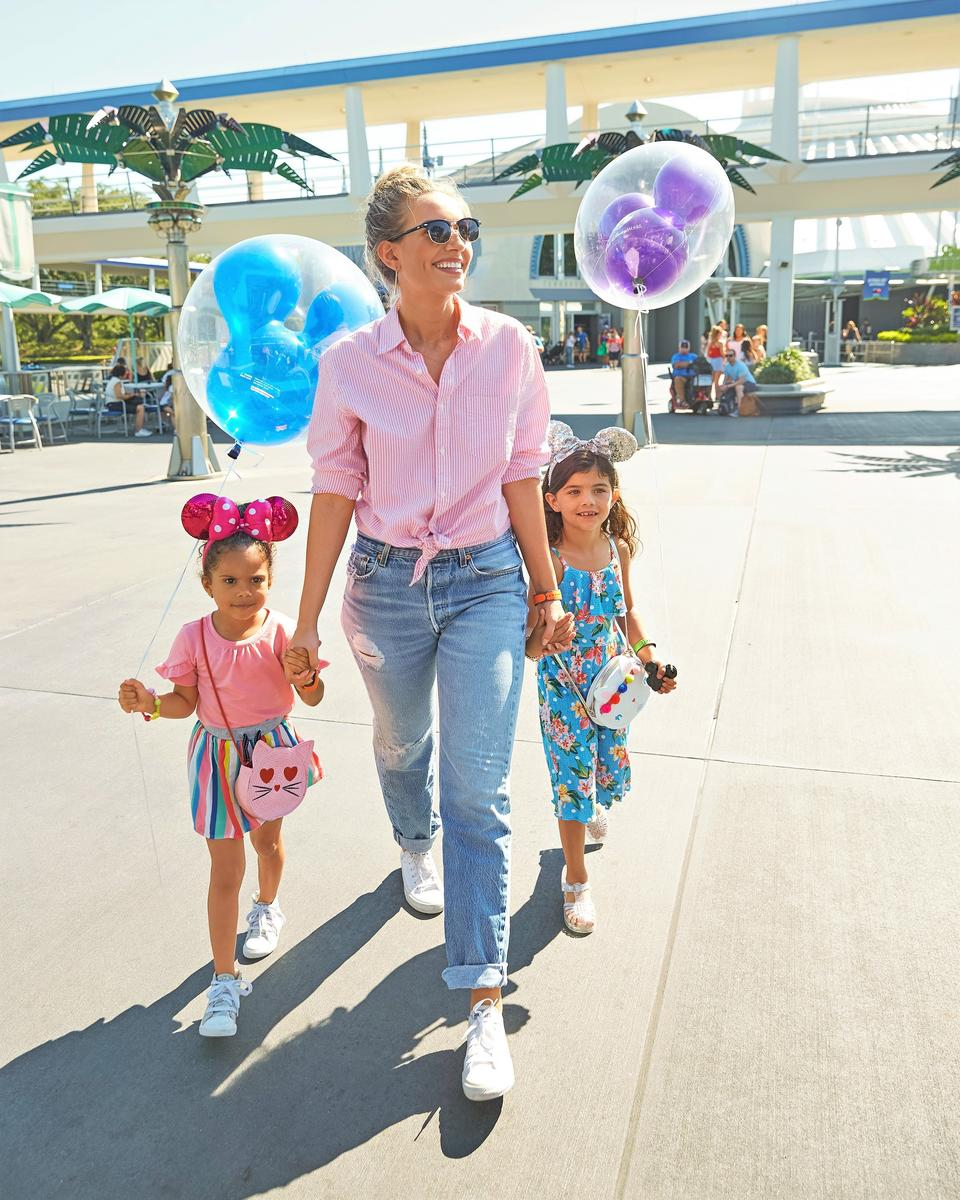 Woman and Kids Walking Holding Disney Balloons
