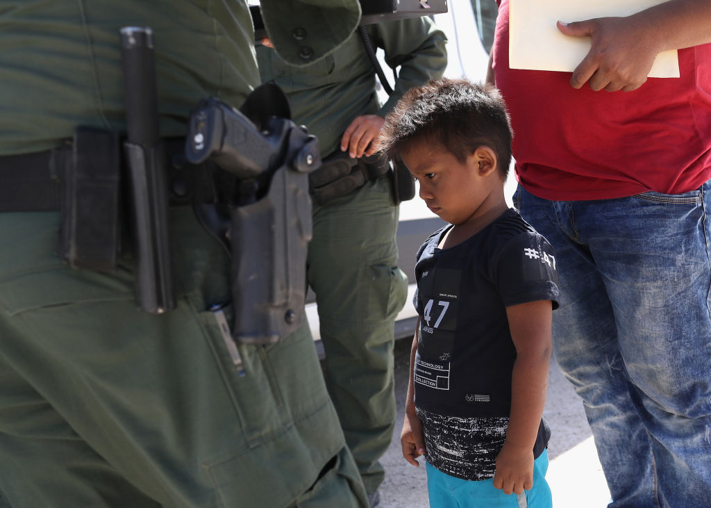 Migrant Child and Border Control Agent
