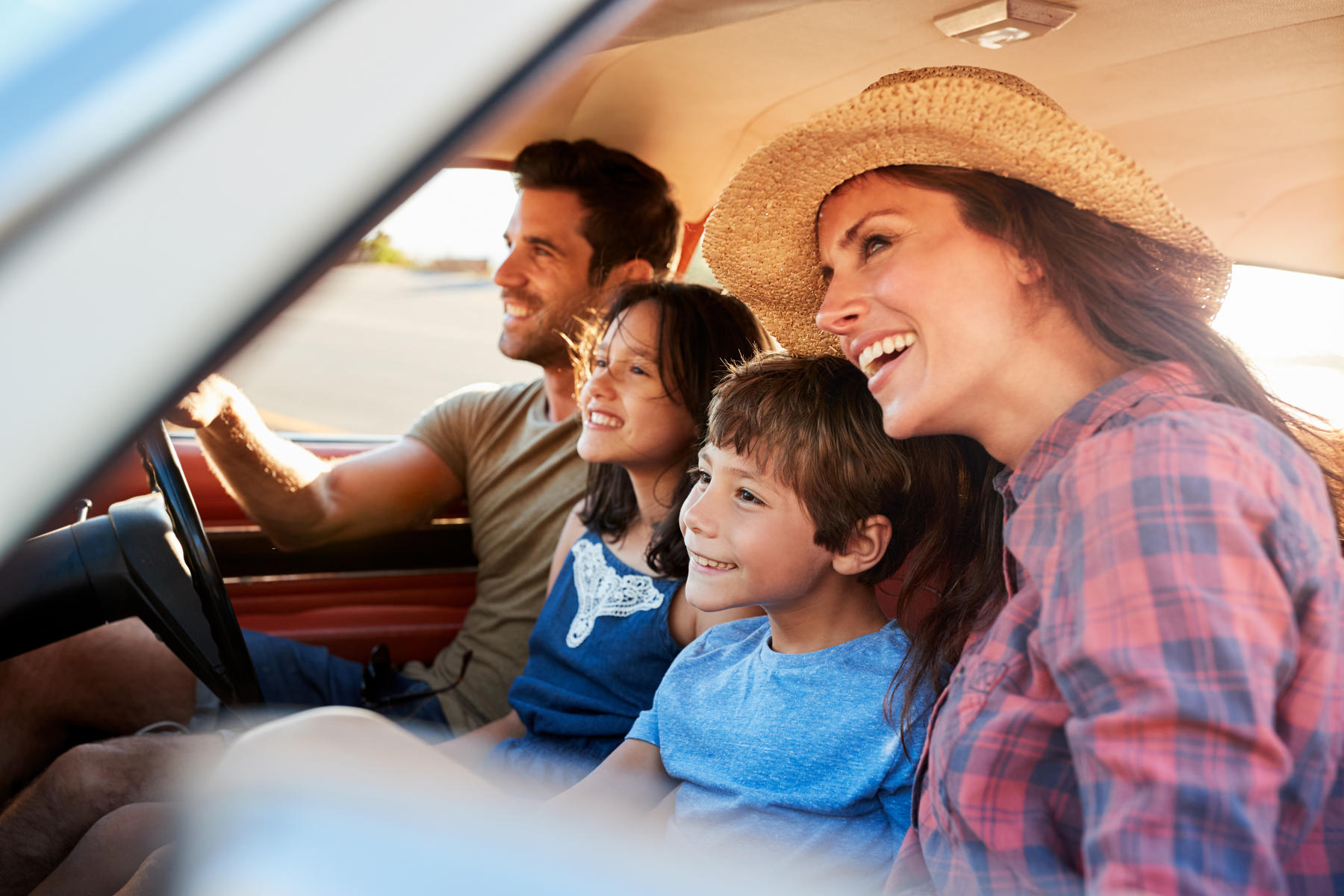 Family Relaxing In Car During Road Trip