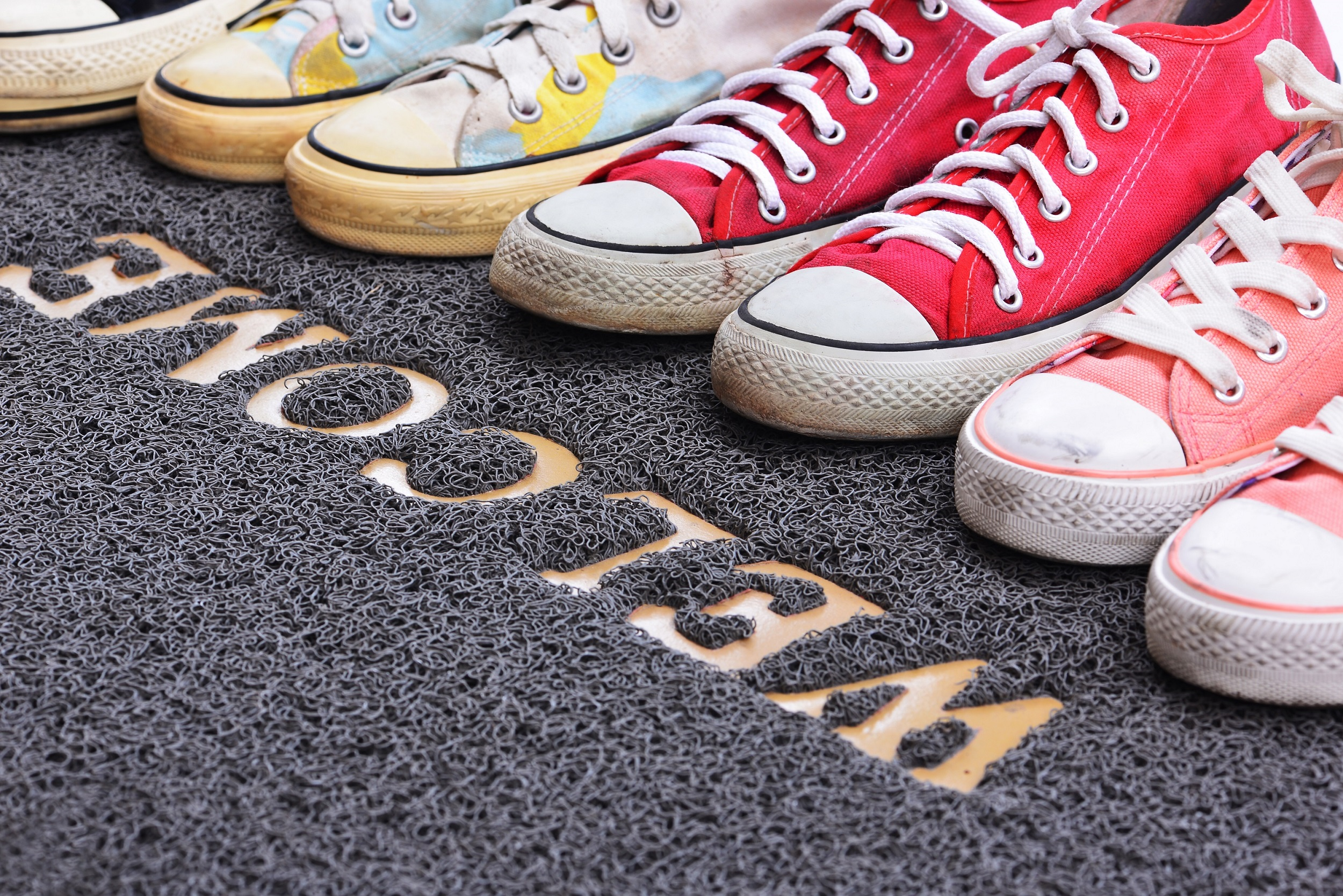 Converse Sneakers on Welcome Mat