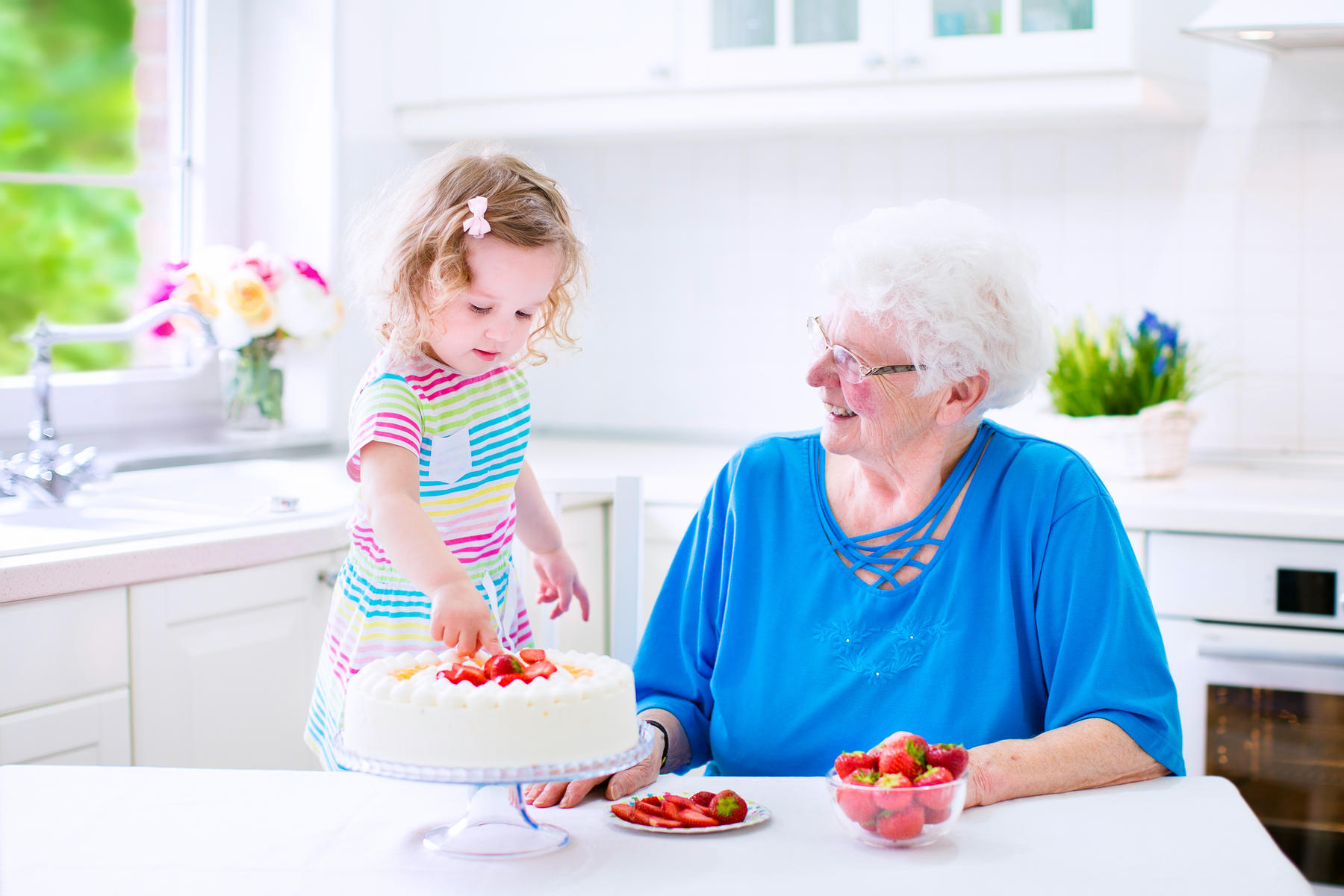 Grandma and Granddaughter Making Strawberry Shortcake