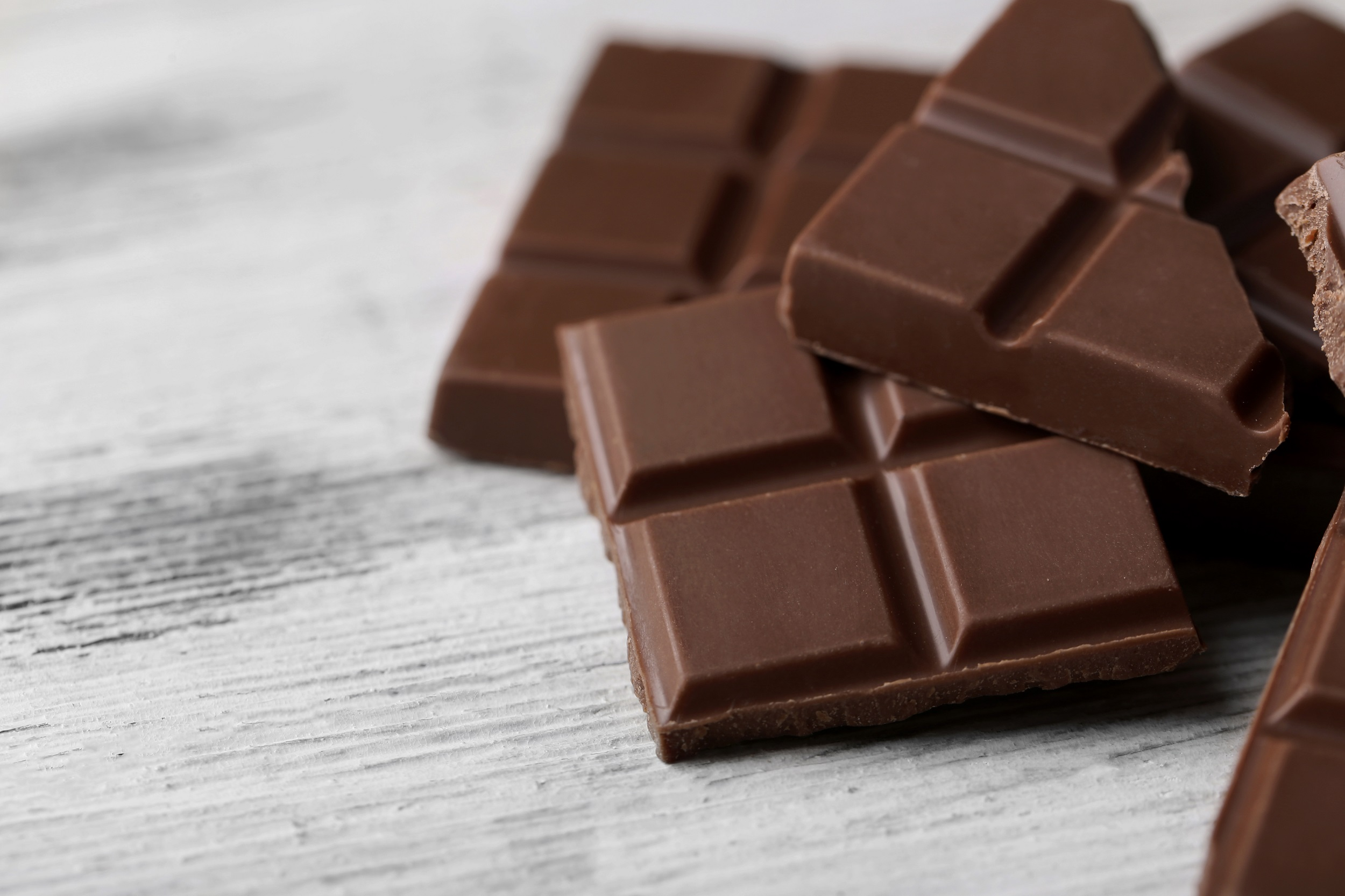 Chocolate Bar Squares White Wood Background
