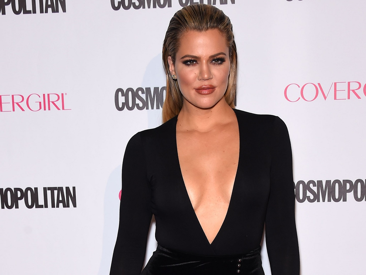 Khloe Kardashian Slicked Hair Back Deep V Neck Black Dress