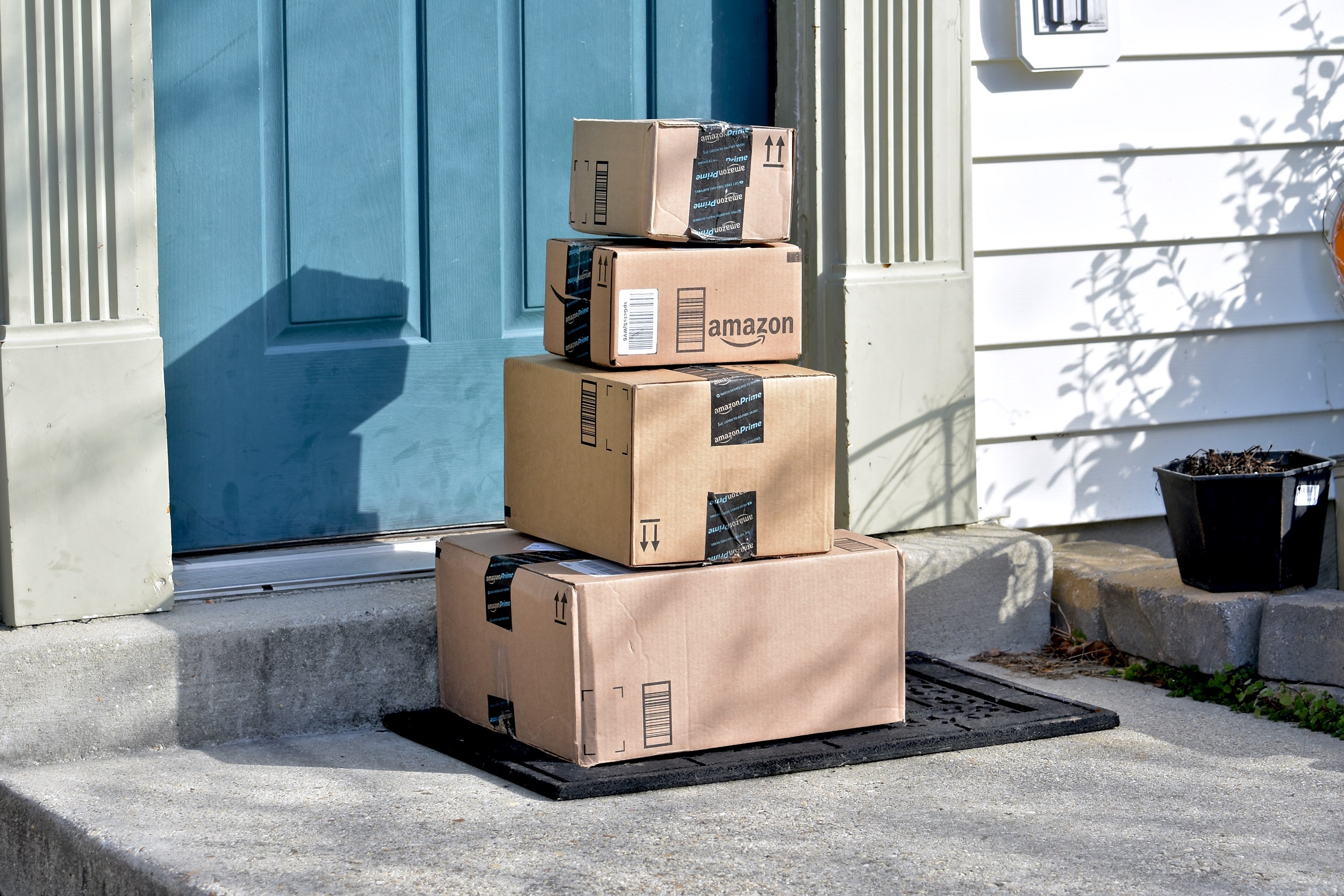 Pile of Amazon Boxes on Doorstep